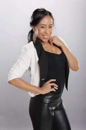 black pants: Nice caribbean girl in fashionable attire Stock Photo