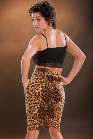 Girl in animal print on tan Stock Photo