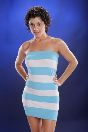 Cute mediterranean young woman in beach attire