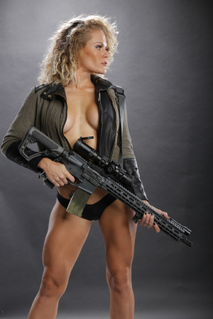 Blond with hi power rifle Stock Photo