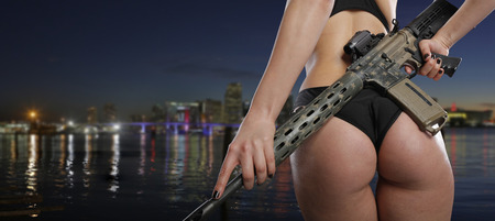 Woman carrying a rifle Stock Photo