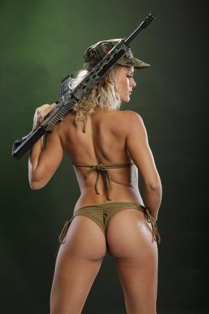 Blond bares a hi power rifle
