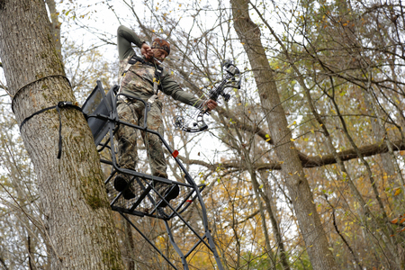 Bow hunter tree stand ladder climb