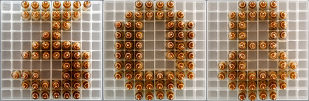 308 caliber sign composed with rifle rounds on ammo trays