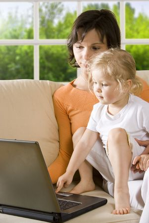 CLIPPING PATH! Mother with daughter on the sofa Stock Photo