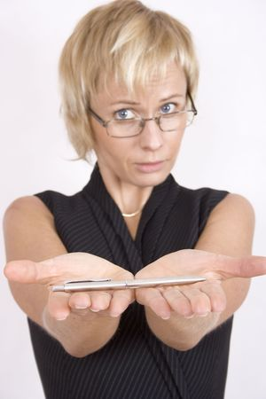gave: Businesswoman gave you a pen to sing a contract Stock Photo