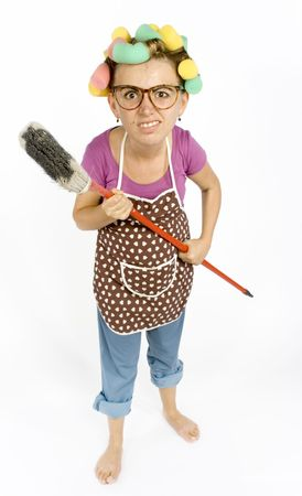 exaggerate: caricature of housewife - threaten by broom Stock Photo