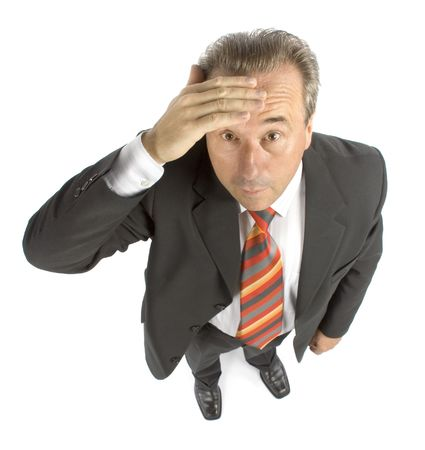 syndicate: disagreeably senior businessman - hand on head Stock Photo