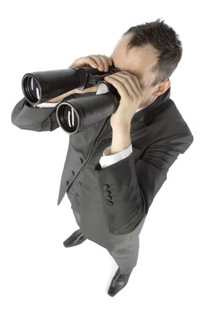 business concept - businessman with binoculars photo