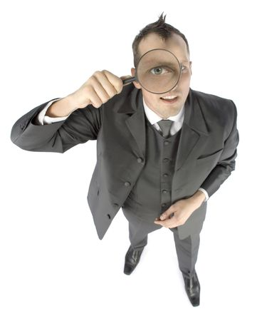 distinguish: business concept - businessman with magnifying glass