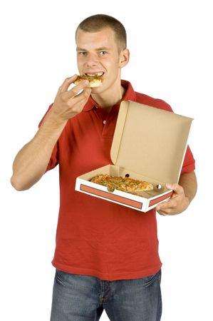 nutriments: aislados hombre come pizza  Foto de archivo