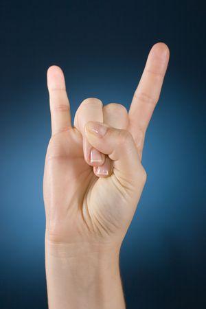 embody: womans hand make symbol Stock Photo