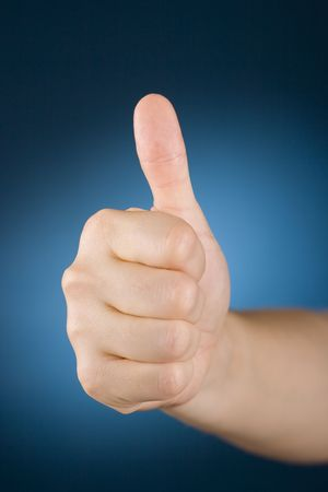 approbation: womans hand with thumb up Stock Photo