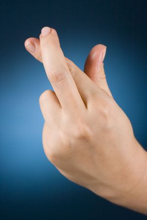 womans hand with crossed fingers photo