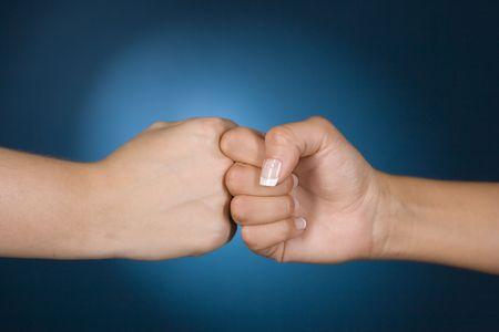 dissension: womans hands show competition gesture