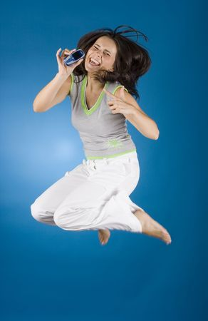 jumping happy woman with cell phone
