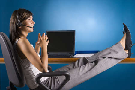 clarify: female office worker on the phone - legs on the desk