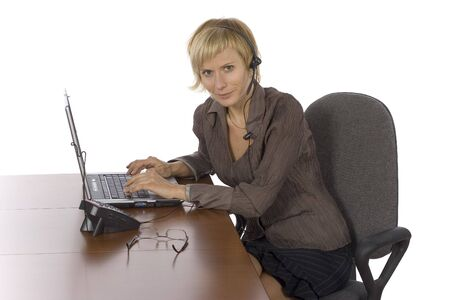 isolated woman at the desk wearing headset Stock Photo - 538639