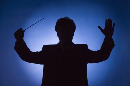 silhouette of conductor on blue background photo