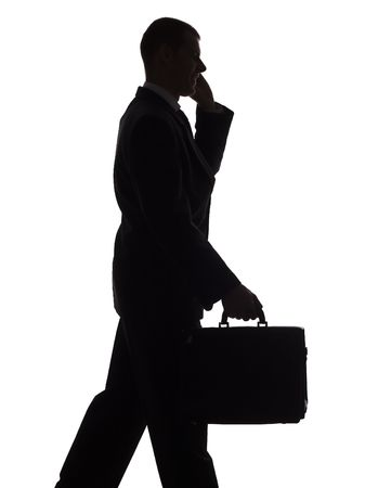 money packs: isolated on white silhouette of walking man with suitcase and cell