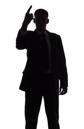 isolated on white silhouette of man with finger up photo