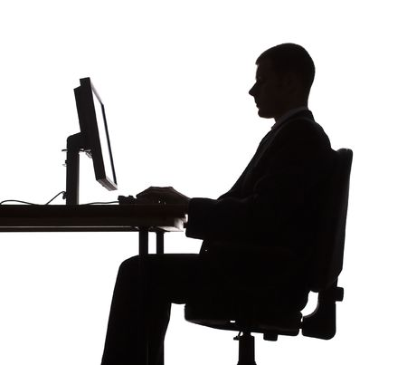 isolated on white silhouette of man working computer photo