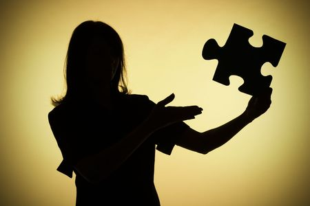 decipher: isolated on gold silhouette of woman with puzzle