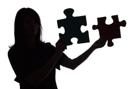 clarify: isolated on white silhouette of woman with puzzle