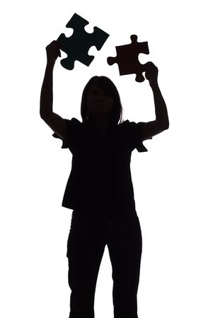 isolated on white silhouette of woman with puzzle