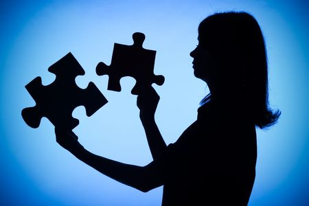 decipher: isolated on blue silhouette of woman with puzzle