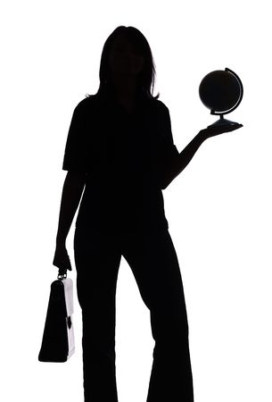 isolated on white silhouette of woman with suitcase and globe photo