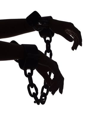 slave girl: isolated on white silhouette of womans hands with chains