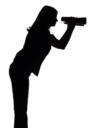 isolated on white silhouette of woman with binoculars photo