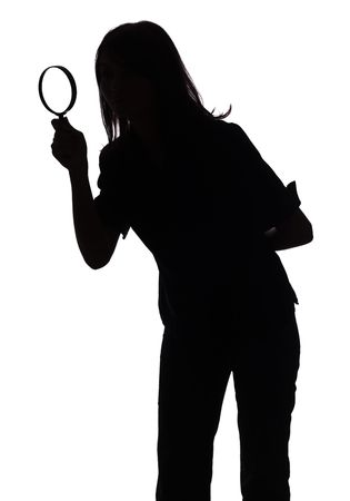 isolated on white silhouette of woman with magnifying glass photo