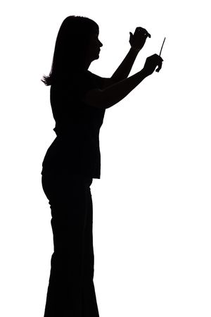 genie woman: isolated on white silhouette of female conductor Stock Photo