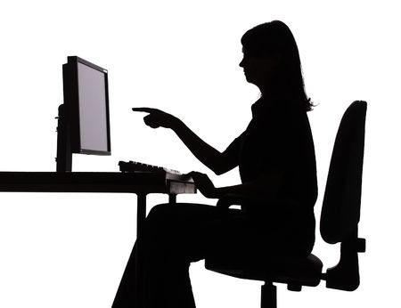 isolated on white silhouette of woman working computer - pointing screen photo