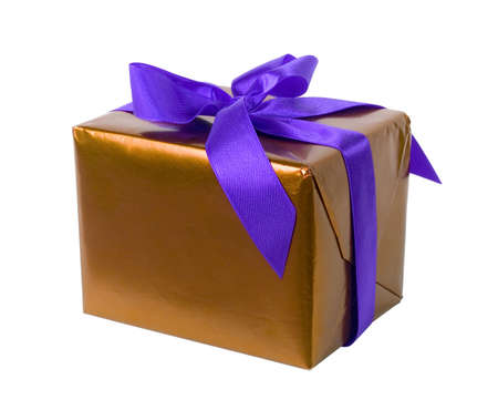 gifting: isolated gift - golden paper and purple ribbon