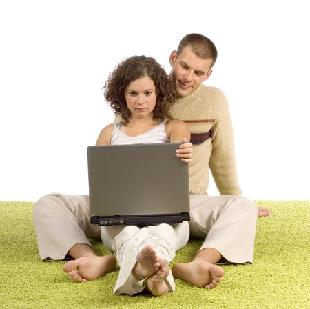 green carpet: isolated on white young couple on green carpet with laptop