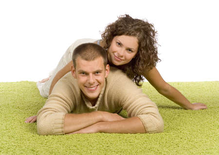 green carpet: isolated on white young couple on green carpet Stock Photo