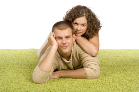 isolated on white young couple on green carpet Stock Photo
