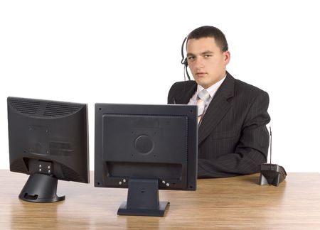 communicaton: isolated on white businessman at he computers screens