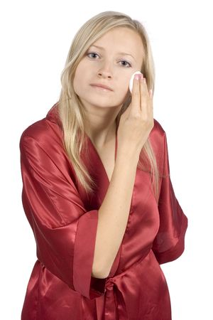 red bathrobe: young woman dressed red bathrobe removal make-up (pure white background)