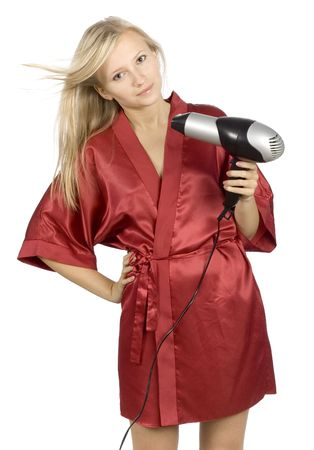 red bathrobe: young woman dressed red bathrobe using  hair drier (pure white background)