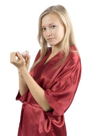 red bathrobe: young woman dressed red bathrobe painting nails (pure white background)