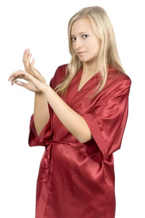 red bathrobe: young woman dressed red bathrobe with cream on her hands (pure white background)