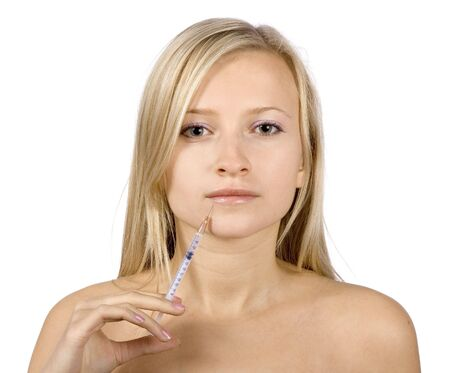 face of young blonde woman + botox injection (pure white background) Stock Photo - 583469