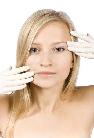 snip: face of young blonde woman + her hands in gloves (pure white background) Stock Photo