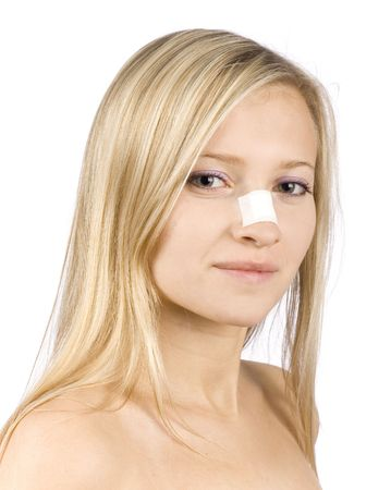 snip: face of young woman with sticking plaster on nose (pure white background)