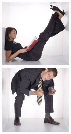 neighbour: businesswoman and businessman working in the cramped white cube Stock Photo