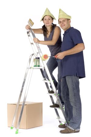 man and woman (workers) at the ladder with paint photo